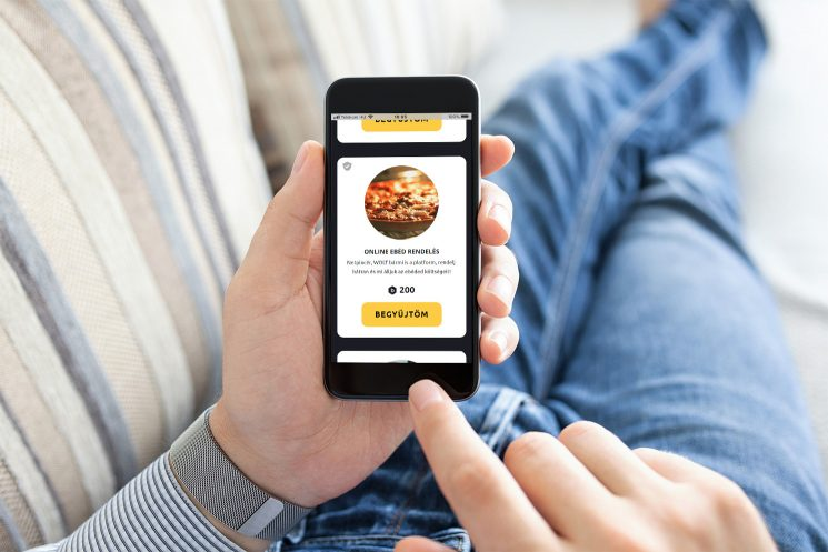 Man Holding Touch Phone With App Delivery Food On Screen